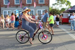 Lady riding bike in the parade
